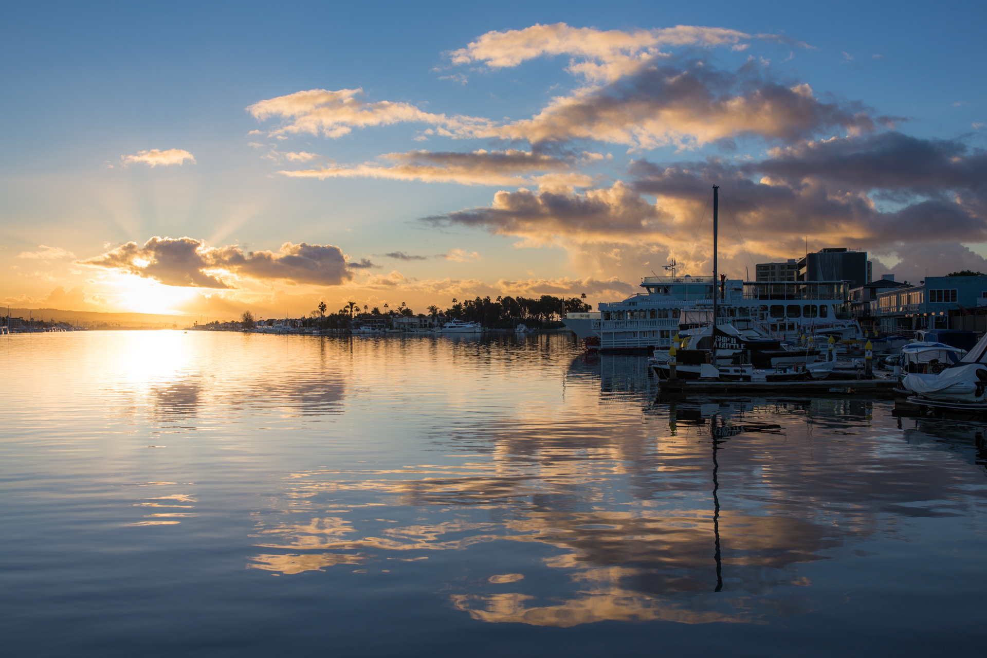 Sunrise reflected in the Newport Beach bay