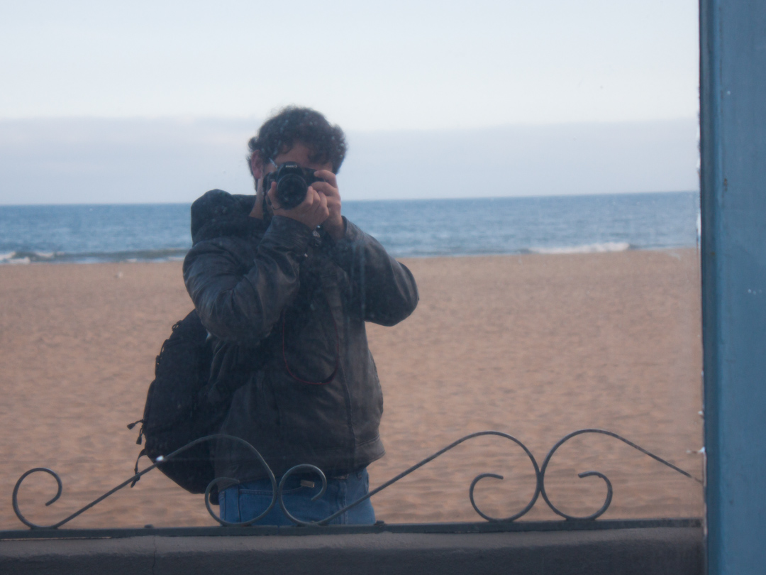 Reflection of photographer in a window